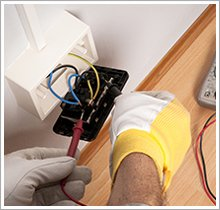 Fixing a wall plug, White and yellow gloves